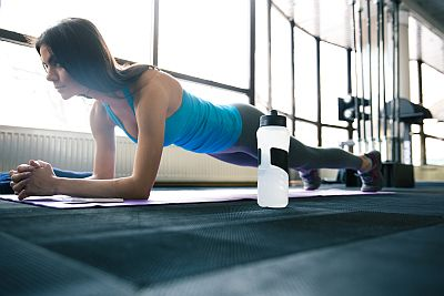 Fit Young Woman doing the Plank Exercise
