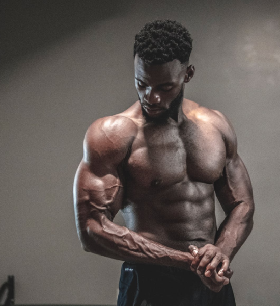 Photo of a Man with a Muscular Body from doing Calisthenic Exercises. Resource: Pexels