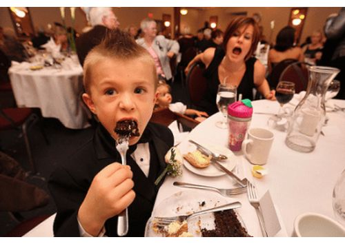 Child Eating Cake when Dining Out