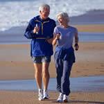 Elderly Couple Walking on the Beach getting 10,000 steps